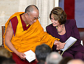 Washington, DC - October 17, 2007 -- The 14th Dalai Lama, Tenzin Gyatso, left, and Speaker of the House Nancy Pelosi (Democrat of California), right, share a light thought during a ceremony where the Dalai Lama accepts the Congressional Gold Medal, the nation's highest and most distinguished civilian award, in Washington, D.C. on Wednesday, October 17, 2007..Credit: Ron Sachs/CNP