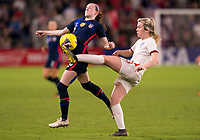 5th March 2020, Orlando, Florida, USA;  the United States midfielder Rose Lavelle sees the ball cleared by the England defender during the Women's SheBelieves Cup soccer match between the USA and England on March 5, 2020 at Exploria Stadium in Orlando, FL.