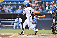 Asheville Tourists first baseman Chad Spanberger (24) swings at a pitch during a game against the Greensboro Grasshoppers at McCormick Field on May 11, 2018 in Asheville, North Carolina. The Tourists defeated the Grasshoppers 10-5. (Tony Farlow/Four Seam Images)