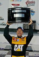 Ward Burton raises his trophy in victory lane after winning the Daytona 500, Daytona International Speedway, Daytona Beach, FL, February 17, 2002.  (Photo by Brian Cleary/www.bcpix.com)
