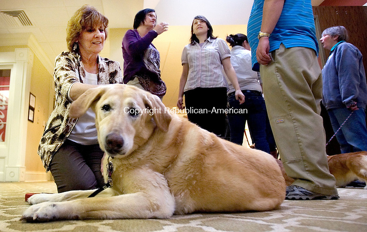 SOUTHBURY CT. 25 March 2014-032814SV10-Denise Julian of Southbury hangs out with &ldquo;Sadie&rdquo; a therapy dog that lives at The Watermark during an indoor dog show at The Watermark at East Hill in Southbury Friday. <br /> Steven Valenti Republican-American