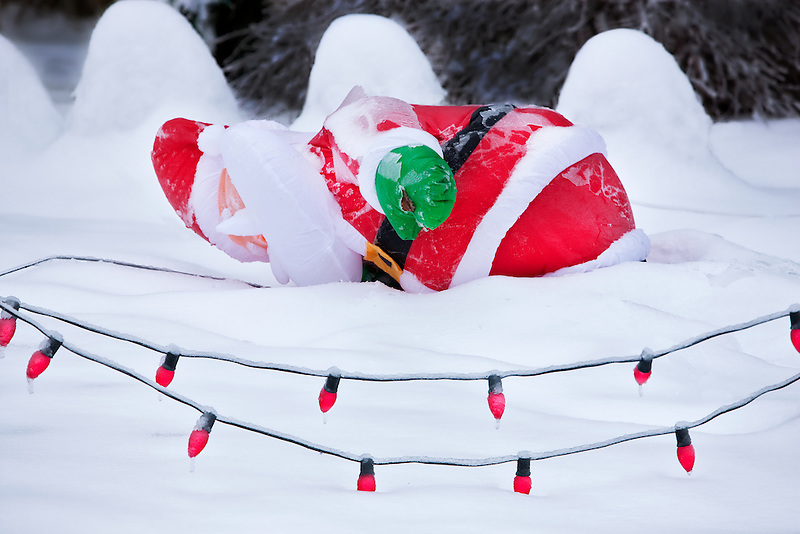 Santa fallen down in snow storm.