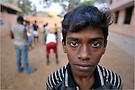 A boy who works as a scavenger in the municipal garbage dump in Chennai, India, is hosted in a nearby night shelter by the Madras Christian Council of Social Service.