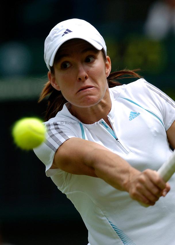 Photo: Richard Lane..Wimbledon Championships. 27/06/2006..Belgium's Justin Henin-Hardenne returns.