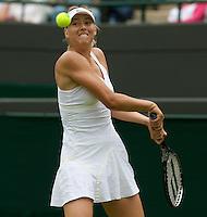 Maria Sharapova (RUS) (24) against Viktoriya Kutuzova (UKR) in the first round of the Ladies SIngles. Sharapova beat Kutuzova 7-5 6-4 ..Tennis - Wimbledon - Day 9 - Wed 1st July 2009 - All England Lawn Tennis Club  - Wimbledon - London - United Kingdom..Frey Images, Barry House, 20-22 Worple Road, London, SW19 4DH.Tel - +44 20 8947 0100.Cell - +44 7843 383 012