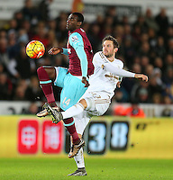 Pedro Mba Obiang of West Ham United and Gylfi Sigurdsson of Swansea City in action during the Barclays Premier League match between Swansea City and West Ham United played at The Liberty Stadium, Swansea on 20th December 2015