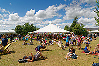 Pictured: People enjoy the sunshine on the festival green.<br /> Re: Hay Festival at Hay on Wye, Powys, Wales, UK. Saturday 02 June 2018