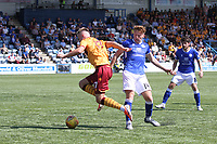 James Scott goes past Andy McCarthy as Lewis Kidd looks on in the SPFL Betfred League Cup group match between Queen of the South and Motherwell at Palmerston Park, Dumfries on 13.7.19.