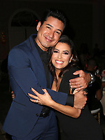 BEVERLY HILLS, CA - OCTOBER 12: ***HOUSE COVERAGE***  Eva Longoria and Mario Lopez at the Eva Longoria Foundation Gala at The Four Seasons Beverly Hills in Beverly Hills, California on October 12, 2017. Credit: Faye Sadou/MediaPunch