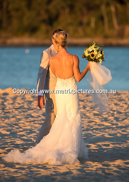27 MAY 2016 NOOSA AUSTRALIA<br /> WWW.MATRIXPICTURES.COM.AU<br /> <br /> NON EXCLUSIVE<br /> <br /> Morgan Kenny marries Ryan Gruell at Noosa Beach. <br /> <br /> <br /> *ALL WEB USE MUST BE CLEARED*<br /> <br /> Please contact prior to use:  <br /> <br /> +61 2 9211-1088 or email images@matrixmediagroup.com.au <br /> <br /> Note: All editorial images subject to the following: For editorial use only. Additional clearance required for commercial, wireless, internet or promotional use.Images may not be altered or modified. Matrix Media Group makes no representations or warranties regarding names, trademarks or logos appearing in the images.