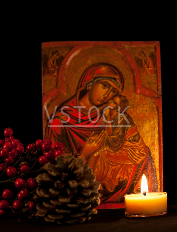 USA California, Fairfax, icon with Virgin Mary and Jesus, candle and pine cone