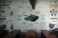 The barrel of a tank and various diagrams of tank systems decorate a classroom in Pyongyang, North Korea (DPRK) on 24 August, 2007.