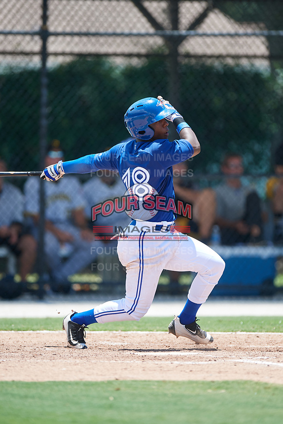 GCL Blue Jays second baseman Jose Theran (18) follows through on a swing during a game against the GCL Pirates on July 20, 2017 at Bobby Mattick Training Center at Englebert Complex in Dunedin, Florida.  GCL Pirates defeated the GCL Blue Jays 11-6 in eleven innings.  (Mike Janes/Four Seam Images)