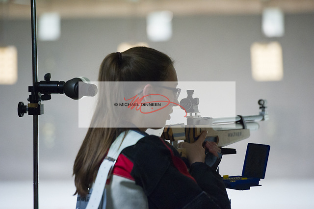 Eagle River Sophomore Maddie Bidinger pauses to steady herself at the Chugiak vs. Eagle River riflery match Friday, Oct. 21, 2016.  Photo for the Star by Michael Dinneen