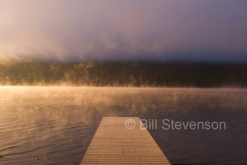 A photo of a boat dock in the early morning at Donner Lake in California.