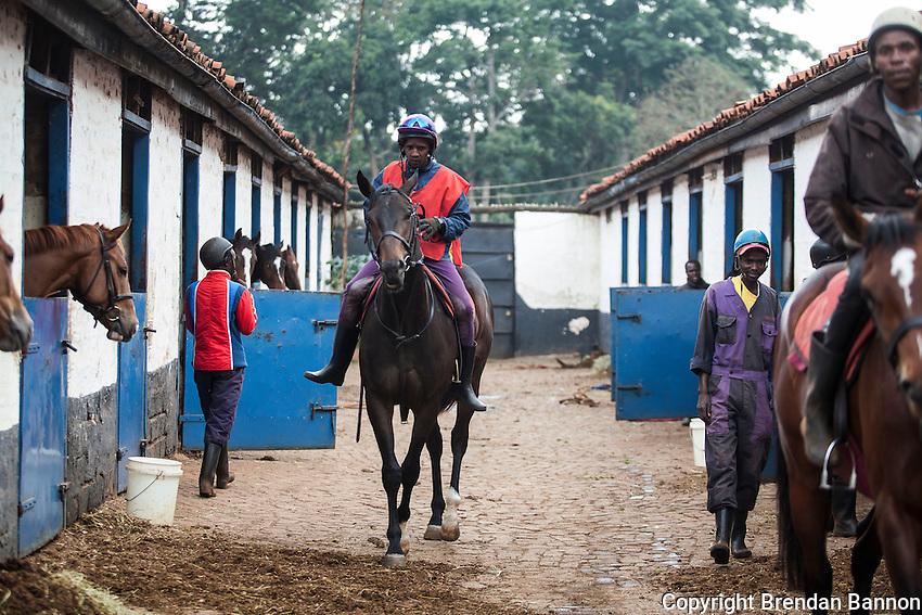 Horses and riders leave the yard of Patsy Sercombe for morning exercise at Ngong Racecourse, Nairobi, Kenya. March 13, 2013. Photo: Brendan Bannon