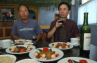 Chinese businessman, Chen Xiuhong eats foie gras with Chinese red wine. Mr chenowns a business that produces fois gras near Beihai, Guangxi. Foie Gras, the French delicacy, made from the liver of geese that have been force fed in now being produced by an enterprising Chinese businessman...PHOTO BY SINOPIX