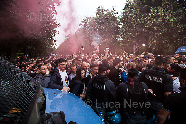 Villa Borghese.<br /> <br /> Rome, 02/05/2018. Following and documenting a group of Liverpool F.C. supporters chanting and cheering on throughout the streets of central Rome while waiting for the Champions League Semi-final (second leg) at the Stadio Olimpico versus A.S. Roma. The supporters were escorted by heavy presence of the Italian Police and Carabinieri, assisted by Merseyside Police's officers (British Police) and by the stewards and staff from Liverpool Football Club. Last week, during the first leg of the semi-final in Liverpool, an English fan was attacked by Italian supporters outside Anfield stadium. However, the day of the match in Rome passed without any serious incidents involving supporters and just one arrest - a Liverpool supporter - was made (on suspicion of common assault and a public order offence). The actual match was played in the evening and saw Liverpool losing 4-2 but due to the aggregate with the first match, 7-6, the &quot;Reds&quot; conquered the access to the Champions League final in Kiev against Real Madrid. A statement from the English club read: &quot;Liverpool would like to thank all supporters who travelled to Rome for Wednesday evening's Champions League meeting with Roma at Stadio Olimpico for their exemplary conduct. Over 5,000 fans made the journey to the Italian capital for yesterday's semi-final second leg, behaving impeccably throughout, with no major incidents reported. LFC also acknowledges the significant resources deployed by Roma, UEFA, Merseyside police, Italian police and security services in Rome to ensure all fans enjoyed a safe visit.&quot;<br /> <br /> For more info about the football teams please click here: http://www.asroma.com/en &amp; http://www.liverpoolfc.com/