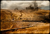 D&amp;RGW K-37 499(?) with stock cars, flat cars and gondola coming around the wide curve at MP 318.6 approaching Osier from the west.  The culvert and fill were installed in 1936 to replace a trestle.<br /> D&amp;RGW  Osier, CO