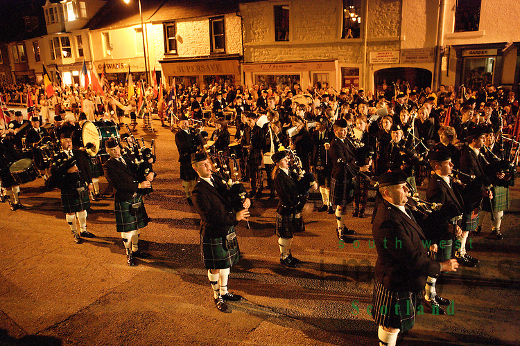 Kirkcudbright Tattoo Scotland UK a mixture of bagpipers pipebands and Stewartry Wind Band and Galloway Pipers playing at night