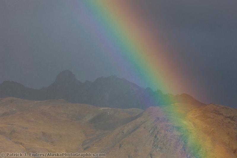 Rainbow arcs over the Alaska Range mountains in Denali National Park, Interior, Alaska.