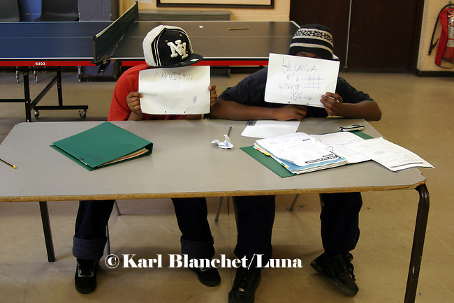 two boys showing their tags during a math session