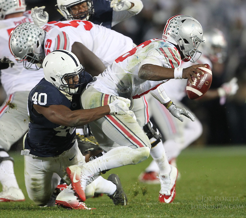 State College, PA - 10/22/2016:  Penn State LB Jason Cabinda (40) sacks Ohio State QB J.T. Barrett for a 13 yard loss late in the fourth quarter to help seal the win. Penn State upset #2 Ohio State by a score of 24-21 on Saturday, October 22, 2016, at Beaver Stadium in University Park, PA.<br /> <br /> Photos by Joe Rokita / JoeRokita.com