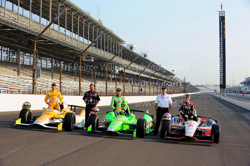 The front row, (L to R): Ryan Hunter-Reay (#28), James Hinchcliffe (#27) and polesitter Ryan Briscoe (#2) with Michael Andretti and Roger Penske.
