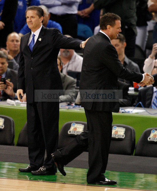 UK head coach John Calipari pats Kansas Head Coach Bill Self on the back before the beginning of the first half of the Kentucky vs. Kansas National Championship game at the Super Dome in New Orleans, Louisiana  April 2, 2012. Photo by Brandon Goodwin | Staff