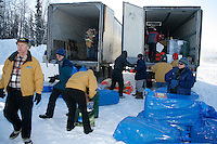 Volunteer pilots and load handlers unload vans at the Willow airport during the first day of flying straw, musher's dog food bags and people food & gear out to checkpoints south of the Alaska Range.  Saturday Feb. 21, 2009   Iditarod 2009