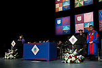 Stuart Dybek, poet and fiction writer, center, receives an honorary degree Saturday, June 10, 2017, during the DePaul University School for New Learning commencement ceremony at the Rosemont Theatre in Rosemont, IL. (DePaul University/Jeff Carrion)