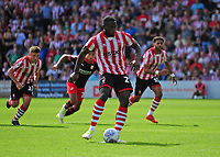 Lincoln City's John Akinde scores the opening goal from the penalty spot<br /> <br /> Photographer Andrew Vaughan/CameraSport<br /> <br /> The EFL Sky Bet League Two - Lincoln City v Swindon Town - Saturday August 11th 2018 - Sincil Bank - Lincoln<br /> <br /> World Copyright &copy; 2018 CameraSport. All rights reserved. 43 Linden Ave. Countesthorpe. Leicester. England. LE8 5PG - Tel: +44 (0) 116 277 4147 - admin@camerasport.com - www.camerasport.com