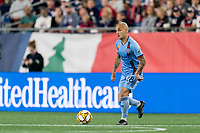 FOXBOROUGH, MA - SEPTEMBER 29: Alexandru Mitrita #28 of New York City FC dribbles during a game between New York City FC and New England Revolution at Gillette Stadium on September 29, 2019 in Foxborough, Massachusetts.