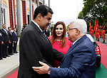 Palestinian President Mahmoud Abbas meets with Venezuelan President Nicolas Maduro at the Miraflores presidential palace in Caracas on May 7, 2018. Photo by Thaer Ganaim