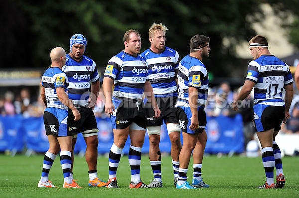 Bath players look on during a break in play. Pre-season friendly match, between Bath Rugby and the Scarlets on August 16, 2014 at the Recreation Ground in Bath, England. Photo by: Patrick Khachfe / Onside Images