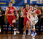 BROOKINGS, SD - JANUARY 17:  Gabbie Boever #4 from South Dakota State pushes the ball past Kelly Stewart #15 and Jasmine Trimboli #5 from the University of South Dakota in the second half of their game Sunday afternoon at Frost Arena in Brookings, S.D. (Photo by Dave Eggen/Inertia)