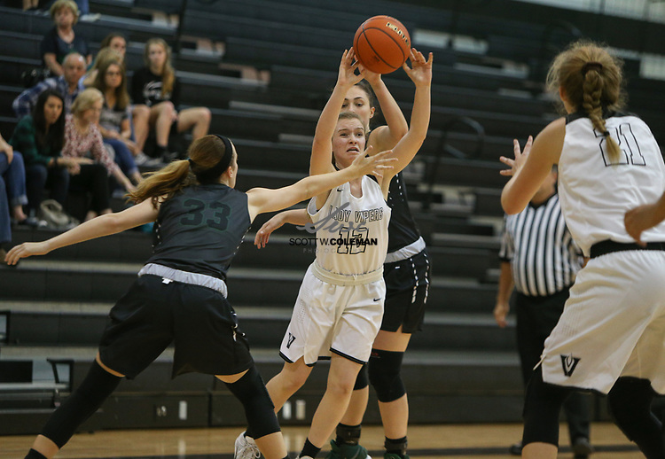 Vandegrift Vipers guard Jen Moore (12) passes the ball  during a girls high school basketball game between the Vandegrift Vipers and the Cedar Park Timberwolves at Vandegrift High School in Austin, Texas on November 14, 2017.