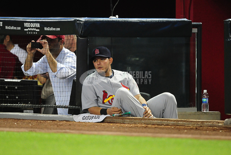 May 9, 2012; Phoenix, AZ, USA; St. Louis Cardinals injured catcher Yadier Molina watches from the dugout in the first inning against the Arizona Diamondbacks at Chase Field. Mandatory Credit: Mark J. Rebilas-