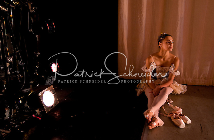 A young dancer rests between scenes during the popular Nutcracker performance at the Belk Theater in downtown Charlotte, NC. The production was performed by the North Carolina Dance Theatre.