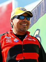 Jun. 1, 2014; Englishtown, NJ, USA; NHRA funny car driver Cruz Pedregon celebrates after winning the Summernationals at Raceway Park. Mandatory Credit: Mark J. Rebilas-