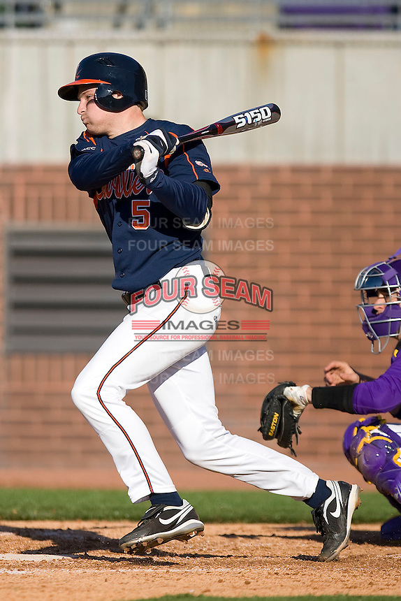 Phil Gosselin #5 of the Virginia Cavaliers follows through on his swing versus the East Carolina Pirates at Clark-LeClair Stadium on February 19, 2010 in Greenville, North Carolina.   Photo by Brian Westerholt / Four Seam Images