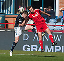 Dundee's Stephen McGinn and Aberdeen's Andrew Considine challenge for the ball.