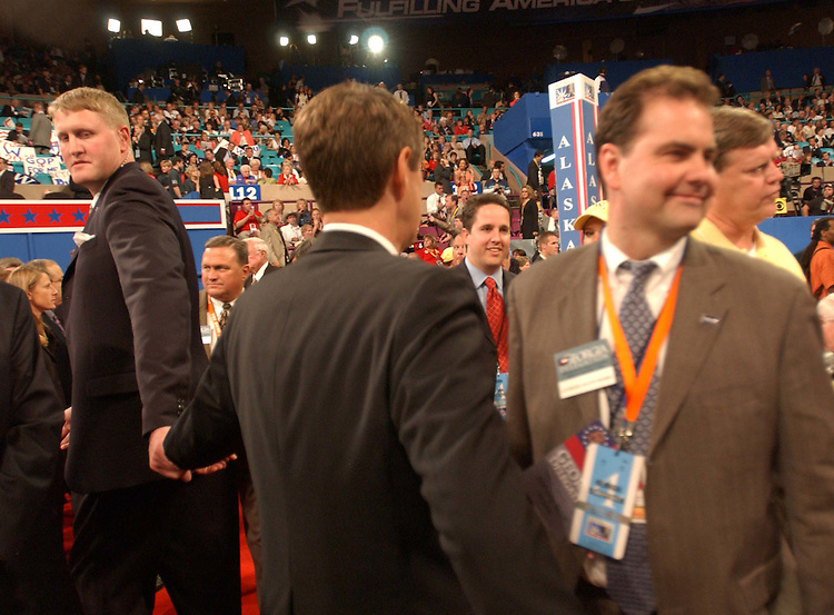 9/01/04.2004 REPUBLICAN NATIONAL CONVENTION--A guard for Senate Majority Leader Bill Frist, R-Tenn., leads him through the crowd on the floor during the Republican National Convention..CONGRESSIONAL QUARTERLY PHOTO BY SCOTT J. FERRELL
