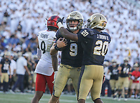 Annapolis, MD - September 23, 2017: Navy Midshipmen quarterback Zach Abey (9) and Navy Midshipmen running back John Brown III (20) celebrates during the game between Cincinnati and Navy at  Navy-Marine Corps Memorial Stadium in Annapolis, MD.   (Photo by Elliott Brown/Media Images International)