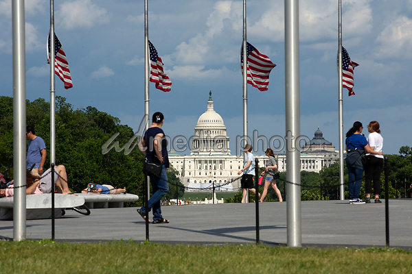 The United States Capitol is seen from the Washington Monument in Washington D.C., U.S., on Saturday, May 23, 2020.  United States President Donald J. Trump ordered American flags to be flown at half-staff until May 24, 2020 to honor the victims of COVID-19.  Credit: Stefani Reynolds / CNP/AdMedia