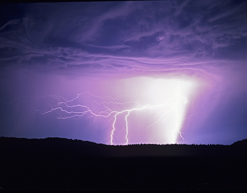 Lightening strikes over farmland. Near Alpine, Oregon