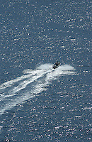 Four men in speed boat, La Gomera, Canary Islands.