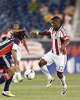 Chivas USA midfielder Miller Bolanos (17) attempts to control the ball. In a Major League Soccer (MLS) match, the New England Revolution tied Chivas USA, 3-3, at Gillette Stadium on August 29, 2012.