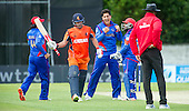ICC World T20 Qualifier - GROUP B MATCH - NETHERLANDS V AFGHANISTAN at Grange CC, Edinburgh - Afghanistan bowler bowler Sharafudin Ashraf (centre) celebrates the wicket of Netherlands bat Peter Borren only to see the decision overturned as a no ball delivery — credit @ICC/Donald MacLeod - 09.07.15 - 07702 319 738 -clanmacleod@btinternet.com - www.donald-macleod.com