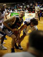 Hawks guard Jon Rogers looks to shoot under pressure from Casey Frank. NBL Semifinal - Wellington Saints v Bay Hawks at TSB Bank Arena, Wellington on Friday, 25 June 2010. Photo: Dave Lintott/lintottphoto.co.nz